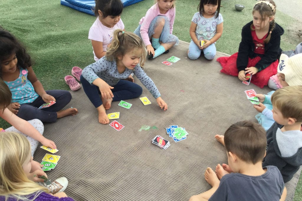 Kids outside playing Uno at Childhood Centre