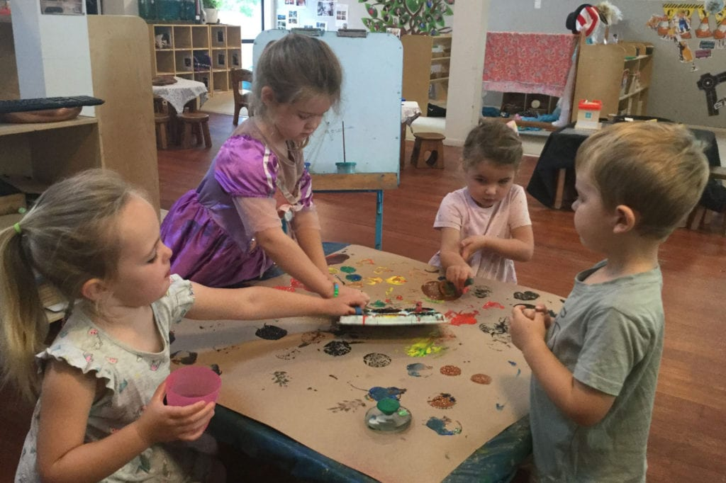 Young children playing with paints at Childhood Centre Hamilton