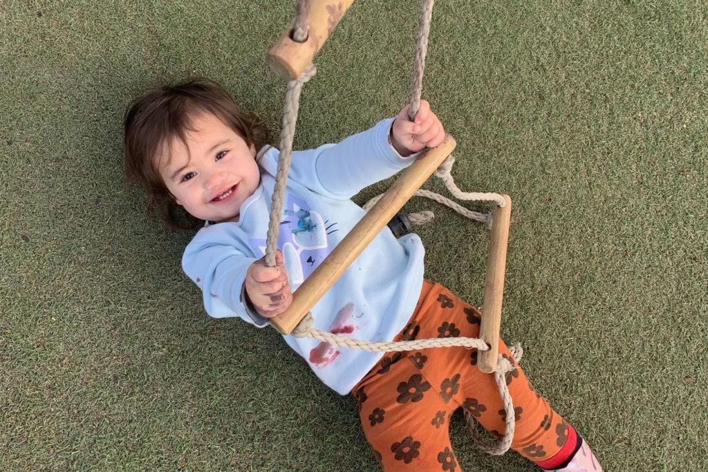 Smiling kid laying on grass